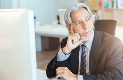 Older man at computer