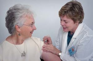 Doctor giving woman an injection
